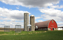 Wisconsin Dairy farm. In a spring setting with a blue sky background royalty free stock image