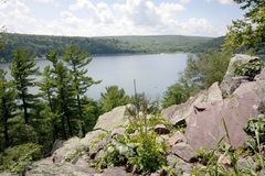 Wisconsin ice age nature background. Beautiful summer landscape with emerald lake at Devils Lake State Park, Baraboo area, Wisconsin, Midwest USA. View from royalty free stock photography