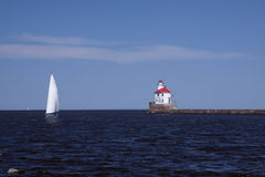 Wisconsin Point Lighthouse. On Lake Superior and a sailboat Royalty Free Stock Photography