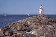 Wisconsin Point Lighthouse. On Lake Superior and a sailboat Royalty Free Stock Images