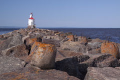 Wisconsin Point Lighthouse. A rock laiden pier leading to Wisconsin Point Lighthouse on Lake Superior Royalty Free Stock Photo