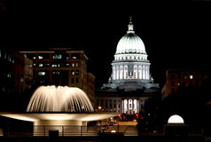 Wisconsin State Capitol building. National Historic Landmark. Madison, Wisconsin, USA. Night scene with official buildings and illuminated fountain on the royalty free stock photography