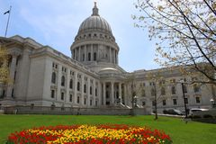 Wisconsin State Capitol building. Spring view with flower bed with bright tulips on a foreground. City of Madison, the capital of Wisconsin, Midwest USA stock photo