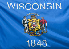 Wisconsin State Flag. A close-up of the Wisconsin state flag waving in the wind stock photos