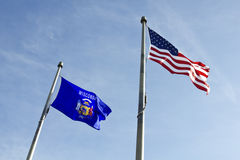 Wisconsin and USA flags. Waving on the wind royalty free stock image