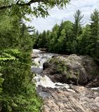 Wisconsin Waterfall. Waterfall in Northern Wisconsin cascades through the wilderness stock photos