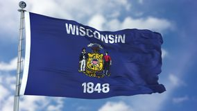 Wisconsin Waving Flag. Wisconsin U.S. state flag waving against clear blue sky, close up, isolated with clipping path mask luma channel, perfect for film, news royalty free stock photography