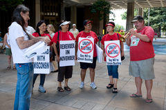 Wisconsin Worker Unions Supporters. Man playing trumpet and female supporters holding signs that says Say No to Union Busting at a rally at the Hawaii State Royalty Free Stock Photography