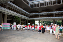 Wisconsin Worker Unions Supporters. Supporters of Wisconsin worker unions and women's rights holding signs in solidarity at a rally at the Hawaii State Capitol Royalty Free Stock Image
