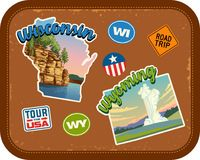 Wisconsin, Wyoming travel stickers with scenic attractions. And retro text on vintage suitcase background Royalty Free Stock Images