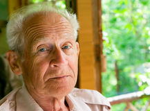 Wisdom. Face portrait of a serious senior man Royalty Free Stock Images