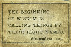 Wisdom CP. The beginning of wisdom is to call things by their right names - ancient Chinese proverb printed on grunge vintage cardboard royalty free stock photo