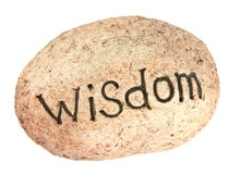 Wisdom rock. The word wisdom written on a rock for a garden Stock Image