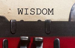 Wisdom wise intellect concept. Typed on an old vintage paper with od typewriter font royalty free stock photos