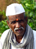Wisdom Wrinkles. A poor old man from an Indian village with a wrinkled face aged with wisdom Stock Image
