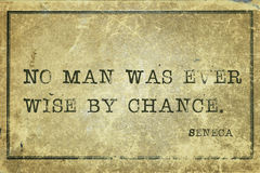 Wise by chance Seneca. No man was ever wise by chance - ancient Roman philosopher Seneca quote printed on grunge vintage cardboard vector illustration