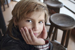 Wise child eyes. Portrait of a boy in a cafe Stock Image