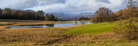Wise Een Tarn. Panorama of Wise Een Tarn in the English Lake District Stock Images