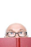 Wise grandfather in glasses holding book Stock Photography