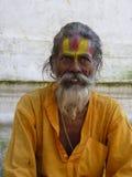 A wise Holy Man, Swayambhunath, Kathmandu. The beautiful face of a Holy Man at the Swayambhunath complex in Kathmandu, Nepal Stock Photos