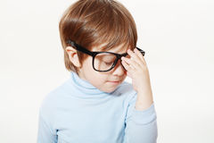 Wise little boy. Looking through big clear glasses Stock Image