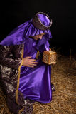 Wise man bowing holding gift Royalty Free Stock Images