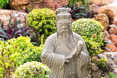 Wise man statue in garden Stock Photos