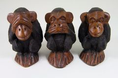 Wise monkeys that see no evil, speak no evil and hear no evil. Three African statuettes of wise monkeys that see no evil, speak no evil and hear no evil royalty free stock photos