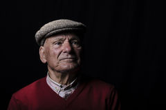 Wise old man. Portrait of a senior farmer of the plains of Sardinia. Portrait with black background Stock Image