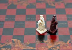 Wise old men Chinese chess pieces. On the chess board royalty free stock images