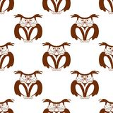 Wise old owl seamless background pattern. In a brown and white vector design with repeat motifs Royalty Free Stock Photography