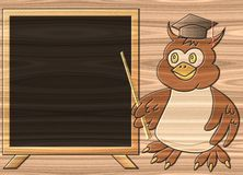 Wise owl relief painting on generated wood backgro Royalty Free Stock Photos