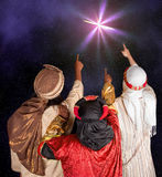Wisemen following a star. Wisemen Caspar Melchior and Balthasar following the star of Bethlehem Stock Images