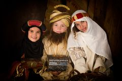 Christmas live reenactment. Wisemen played by three girls in a live Christmas nativity scene stock photography
