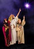 Wisemen watching christmas star Stock Photos
