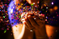 Wish. A girl blows confetti off her hands Stock Photography