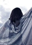 Wish away weather. A girl in a cape wishing away the bad weather approaching Stock Photos