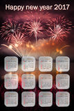 Wish 2017 Calendar and fireworks. Wishes to the new 2017 calendar and fireworks in the background. English text Royalty Free Stock Photo