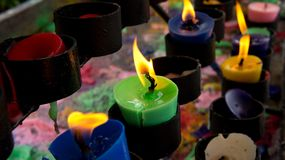 Colorful votive or prayer candles Royalty Free Stock Images