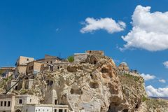 Wish Hill View. Landscape view of famous historical Wish Hill with sandstone caves and limestone buildings on bright blue sky background Royalty Free Stock Photos