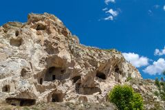 Wish Hill View. Landscape view of famous historical Wish Hill with sandstone caves and limestone buildings on bright blue sky background Stock Photos