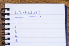 A Wish List in a Note Book Royalty Free Stock Image
