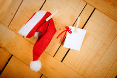 Wish list and Santa cap. Wish list and Santa  cap hanging on a rustic wooden door Stock Photography