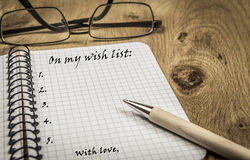 Wish list on spiral notebook Royalty Free Stock Image
