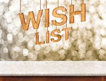 Wish list wood texture with sparkle star hang on marble table wi Royalty Free Stock Photography