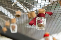 Wish message in a bottle. With red color ribbon Stock Photos