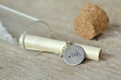 Wish message in a bottle Royalty Free Stock Images