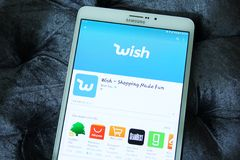 Wish shopping made fun app. Downloading wish online store application on samsung tablet Royalty Free Stock Photo