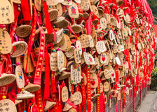 A Wish Wall in China. This is a wish wall in Dujiangyan, Chengdu, Sichuan, China. The wishes are written or drawn on a piece of wood. Most of the wishes are Royalty Free Stock Photo