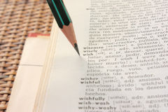 'wish' word in English-Spanish dictionary. With pencil Stock Photography